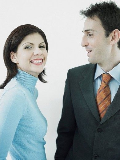 Businesswoman and a businessman smiling together : Stock Photo