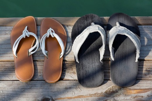 Stock Photo: 1663R-62665 High angle view of flip_flops on a jetty