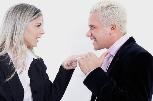 Close_up of a businesswoman blaming a businessman : Stock Photo
