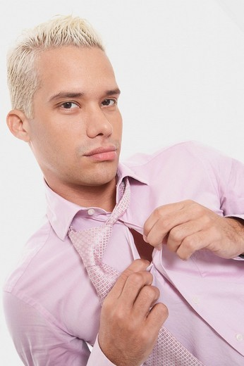 Portrait of a businessman buttoning his shirt : Stock Photo