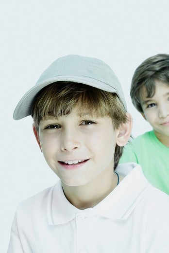 Portrait of a boy smiling with his friend in the background : Stock Photo