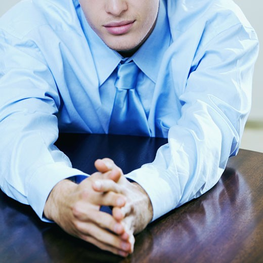 Stock Photo: 1663R-6388 Close-up of a businessman seated at the table