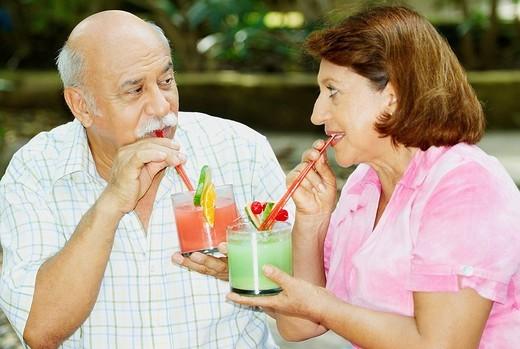 Stock Photo: 1663R-64044 Mature couple drinking juice