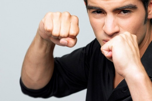 Portrait of a young man making a fist : Stock Photo