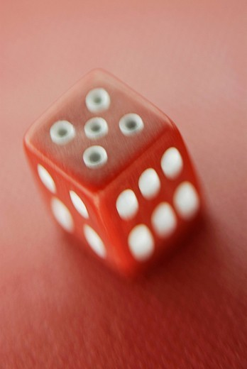 Stock Photo: 1663R-65233 Close_up of a dice
