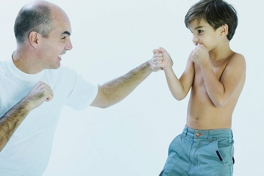 Stock Photo: 1663R-65757 Close_up of a mature man and his son fighting