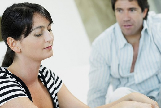 Stock Photo: 1663R-65930 Close_up of a mid adult woman with a mid adult man looking at her