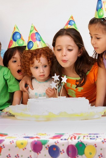 Group of children celebrating a birthday party : Stock Photo