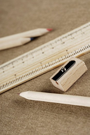 Stock Photo: 1663R-67930 Close_up of colored pencils and a pencil sharpener with a ruler