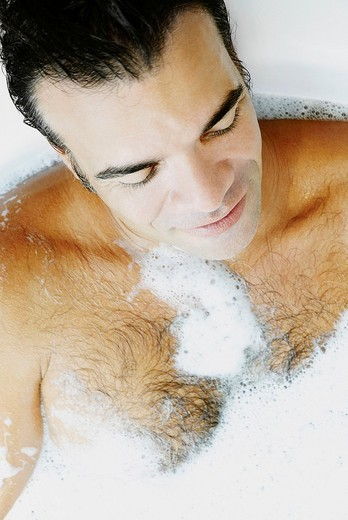 Stock Photo: 1663R-68029 Close_up of a mature man taking bubble bath