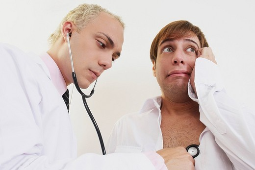 Stock Photo: 1663R-68337 Close_up of a male doctor examining a patient with a stethoscope