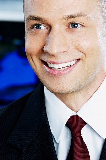 Close_up of a businessman smiling : Stock Photo