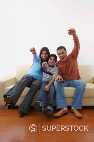 Stock Photo: 1663R-68567 Portrait of a mid adult man and a young woman with their son sitting on a couch