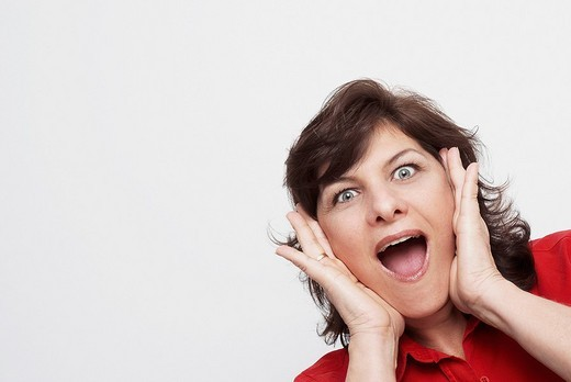 Portrait of a mature woman looking surprised : Stock Photo