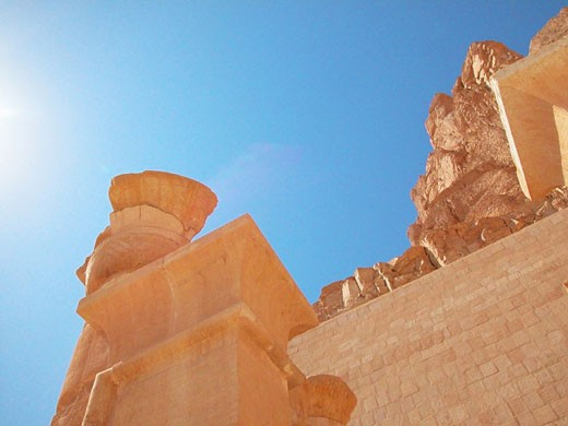 Low angle view of a pedestal along with a column, Egypt : Stock Photo