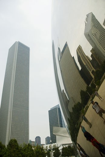 Low angle view of buildings in a city, Cloud Gate Sculpture, Chicago, Illinois, USA : Stock Photo