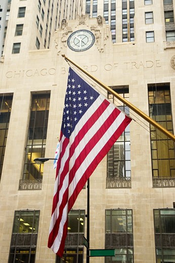 Low angle view of the American flag in front of a building, Chicago Board Of Trade, Chicago, Illinois, USA : Stock Photo