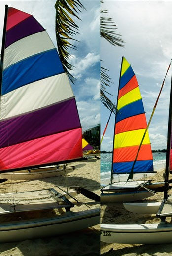 Stock Photo: 1663R-8961 Side view of colorful sailboats on a beach, Nassau, Bahamas