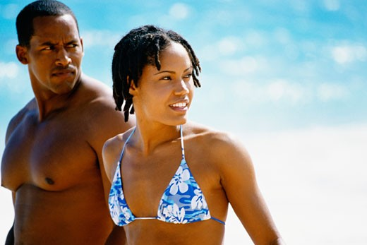 Side view of a couple in swimsuit , Horse-shoe Bay beach, Bermuda : Stock Photo