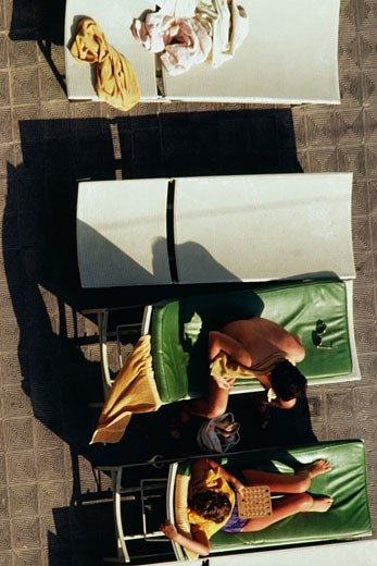 Top view of women sunbathing on deck chairs, San Juan, Puerto Rico : Stock Photo
