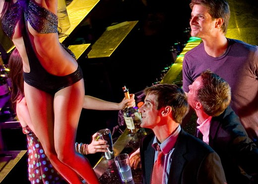 Stock Photo: 1665-105C High angle view of three young men flirting with a dancer in a nightclub
