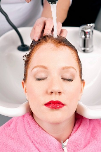 Stock Photo: 1669-14594 young woman at hair salon getting her hair washed