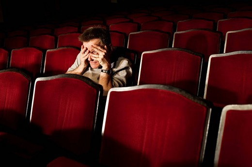 portrait of spectator watching theatre play : Stock Photo