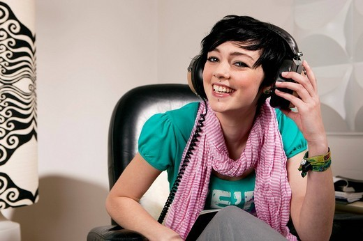 portrait of teenage girl listening to music : Stock Photo