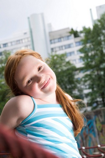 portrait of red haired girl on playground : Stock Photo