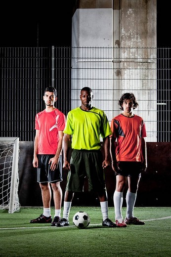 full body portrait of three street football players : Stock Photo