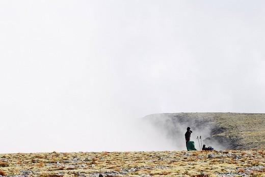backpacker resting on plateau near souther rischorr pass on russian kola peninsula : Stock Photo