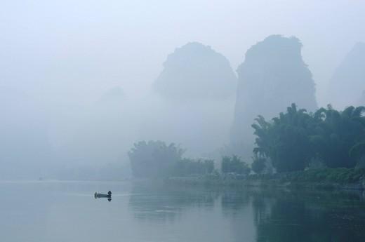 fisherman on Li Rivernear Yangshuo in Guilin region of China : Stock Photo