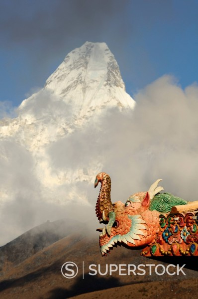 dragon sculpture on roof of gompa at Tengboche in Nepal : Stock Photo