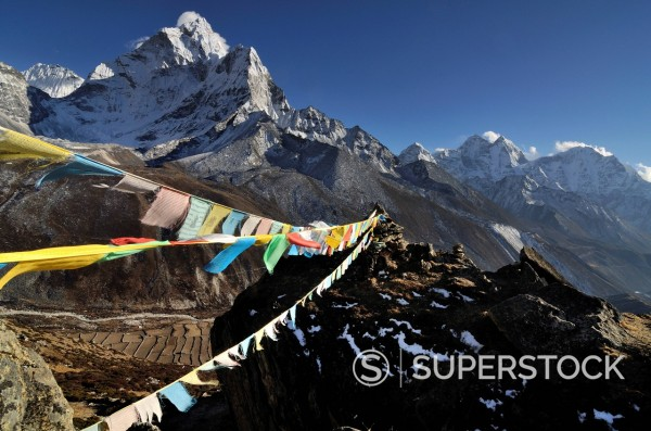 Stock Photo: 1669-33207 buddhist prayer flags in front of Nepal mountains