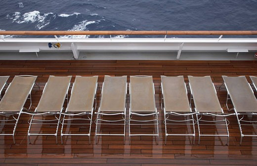 sunloungers on deck of cruise ship : Stock Photo