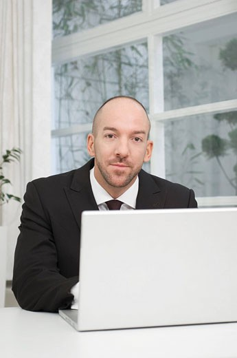 portrait of businessman with laptop computer : Stock Photo