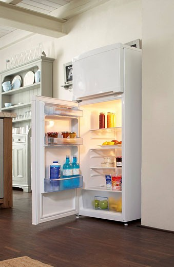 still life of open refridgerator in kitchen : Stock Photo