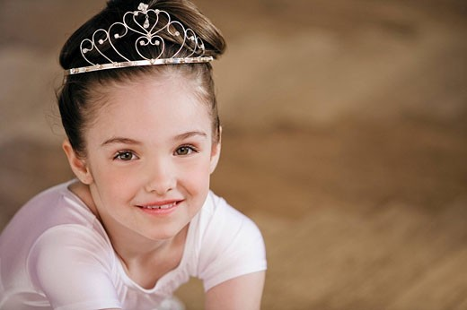 Stock Photo: 1669R-11233 portrait of young ballet dancer wearing little crown