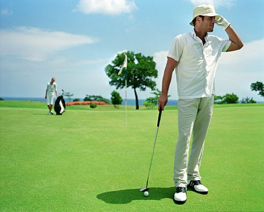 man (30-35 years) on golf course : Stock Photo