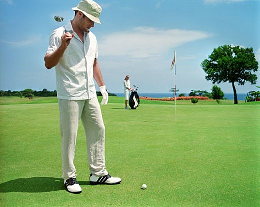 Stock Photo: 1669R-1264 man (30-35 years) on golf course