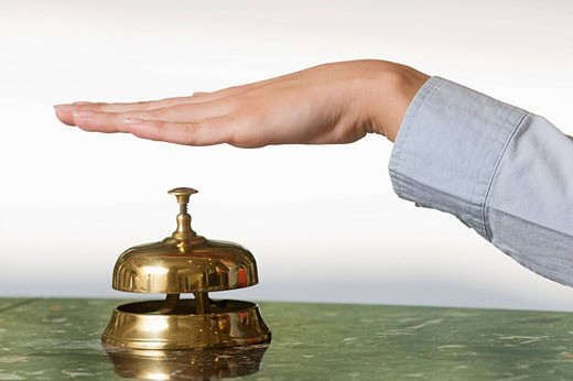 Stock Photo: 1669R-12669 close_up of female hand ringing hotel reception bell