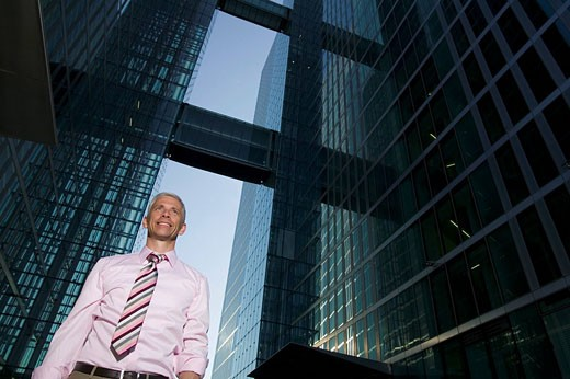 low angle portrait of mature businessman in front of office building : Stock Photo