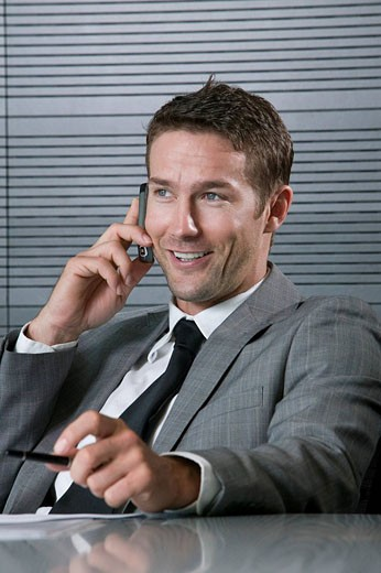 portrait of businessman talking on mobile phone : Stock Photo