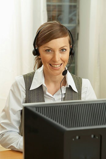 portrait of female call center agent : Stock Photo
