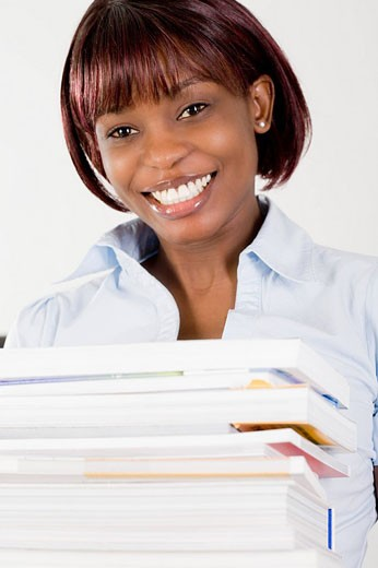 portrait of black office worker with pile of papers : Stock Photo