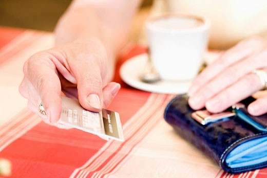 close_up of woman paying with credit card in cafe : Stock Photo