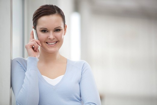 portrait of young businesswoman talking on mobile phone : Stock Photo