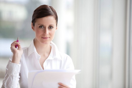 portrait of young woman with document : Stock Photo