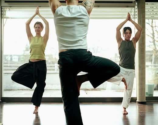 group of people doing yoga exercises in studio : Stock Photo