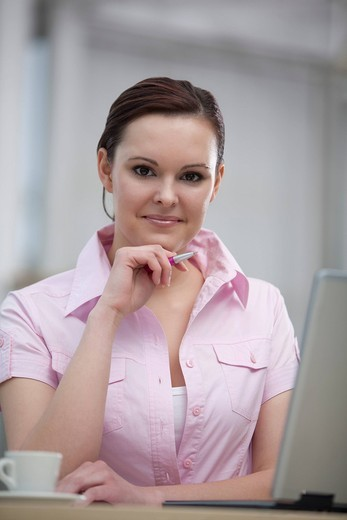 portrait of young businesswoman with laptop computer : Stock Photo